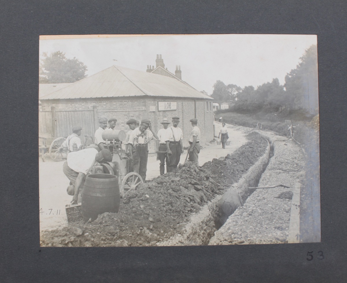 Image for Album of Photographs of Labourers Laying a Water Pipe.